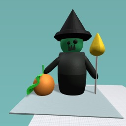 A wich with a broom and pumpkin
